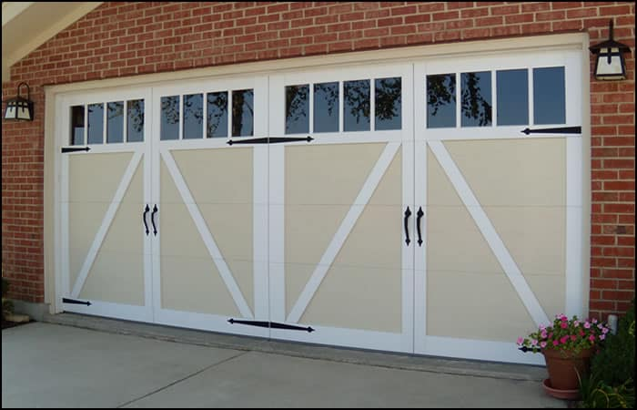 "Carriage Style ""Stockbridge"" garage door in white with decorative hardware"