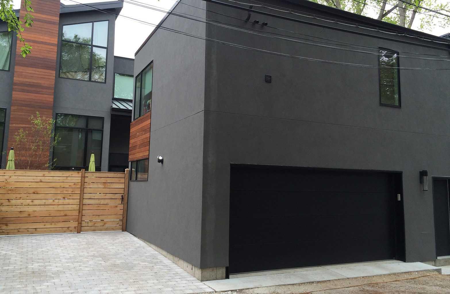 Modern garage door with flush panel