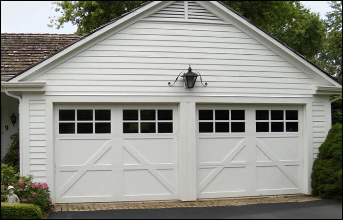 Wood Carriage Style 3-section garage door painted white